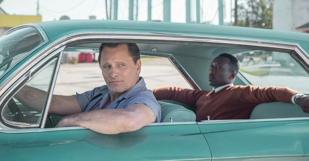 Tony Lip driving Dr Don Shirley in Green Book.