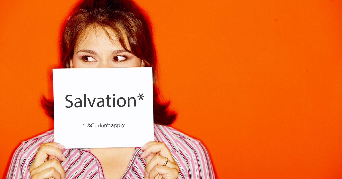 """girl holding a sign which reads """"salvation, t's and c's don't apply"""""""
