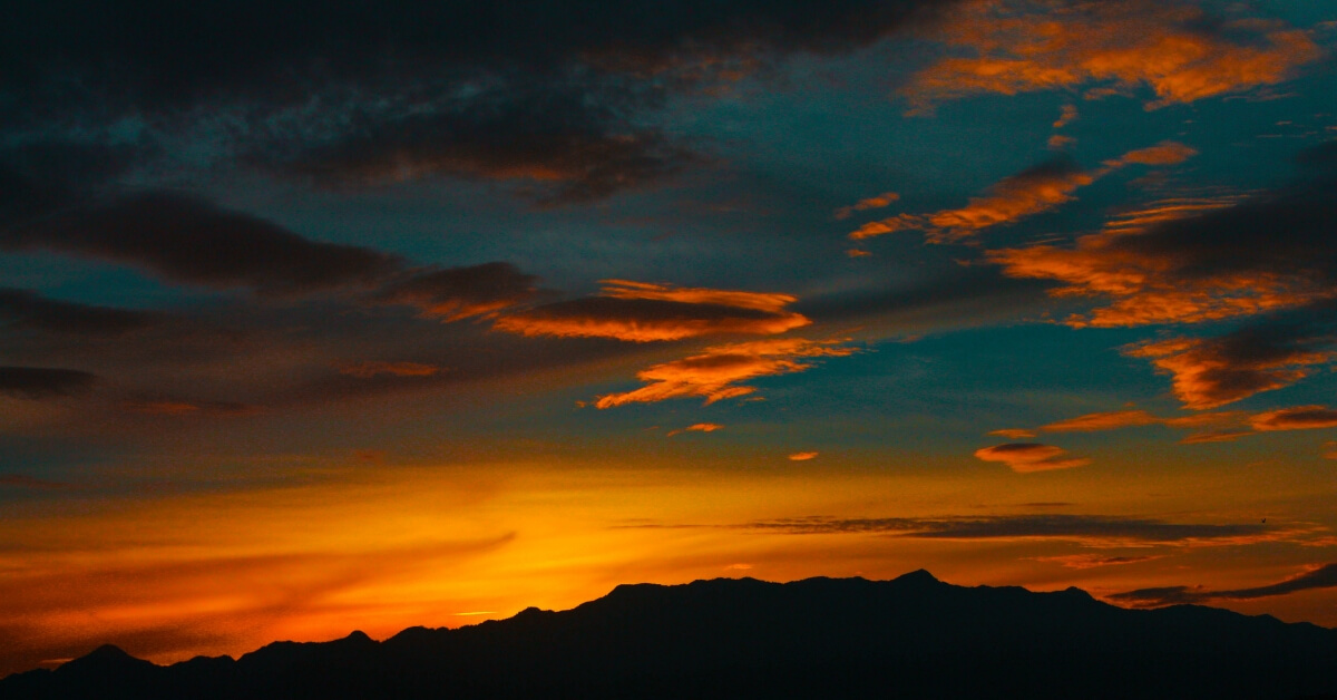 a red sky over mountains