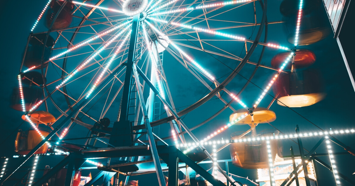 a ferris wheel at night time
