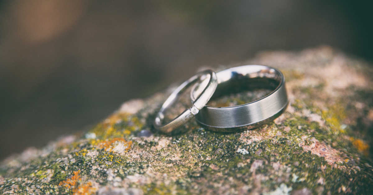 wedding rings on a rock