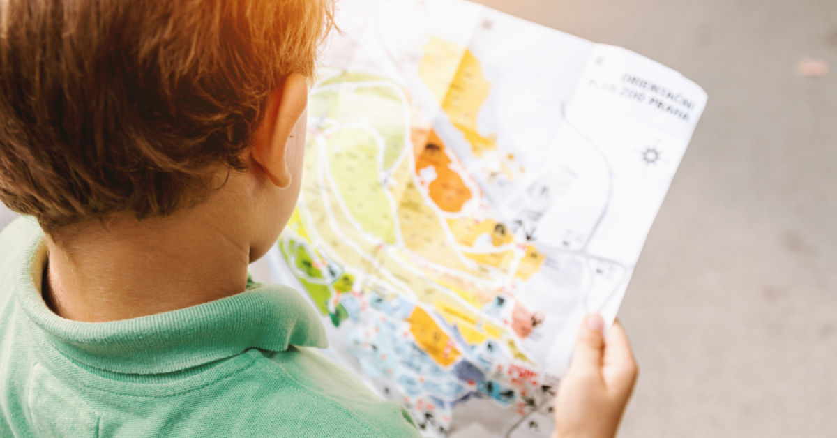 Child holding map