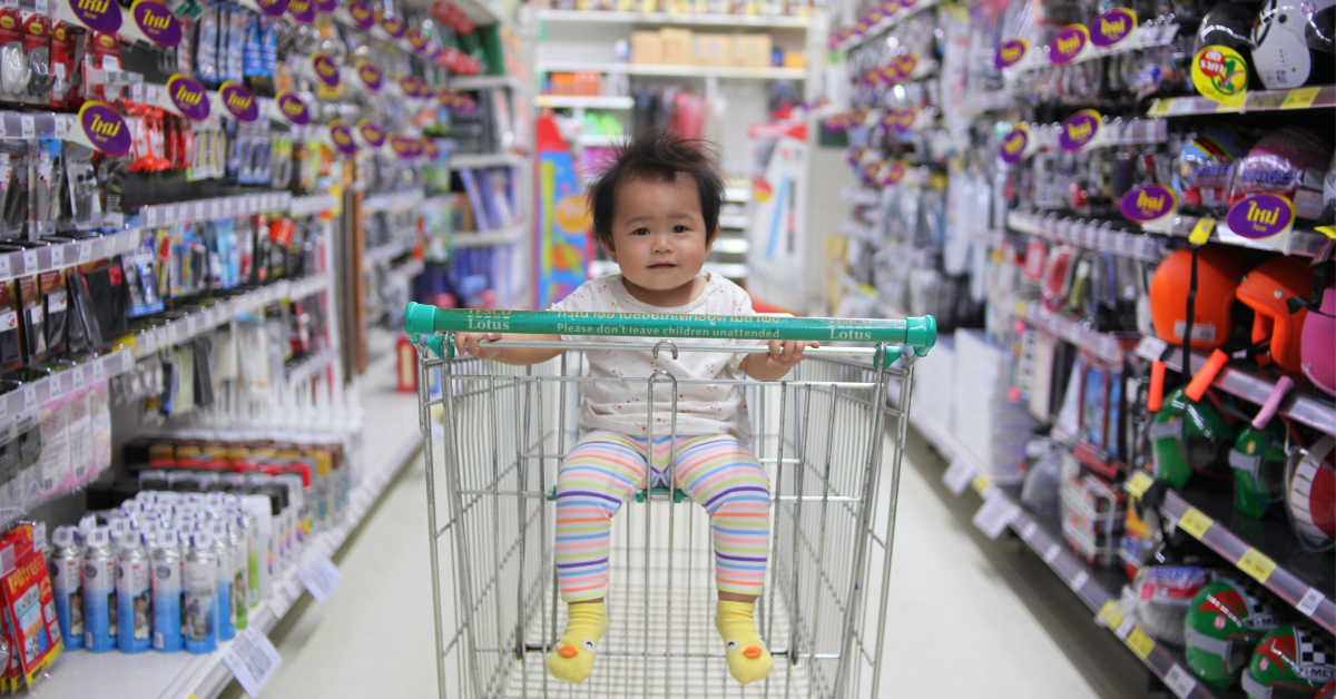 Child in shopping trolley