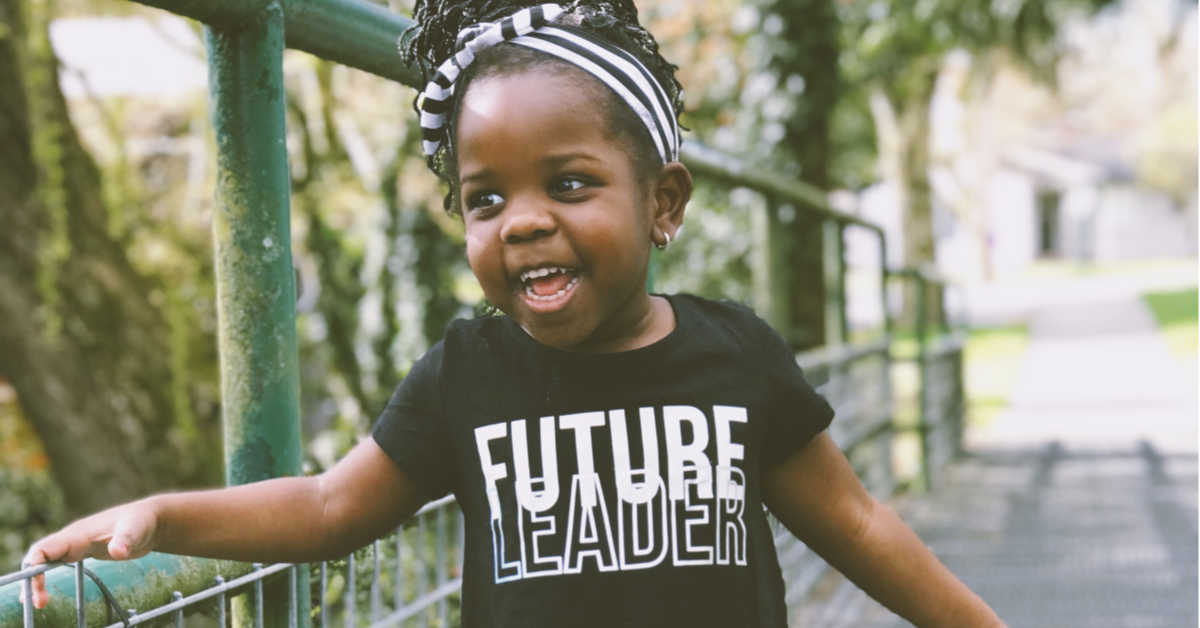 Girl wearing 'future leader' shirt