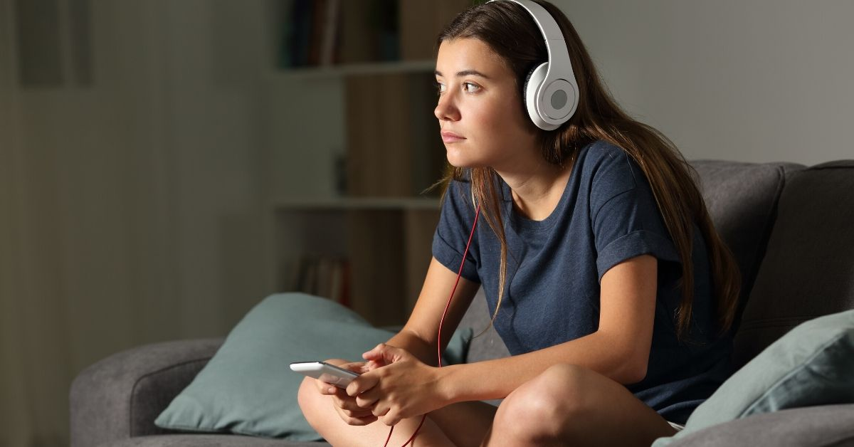 photo of girl with headphones on