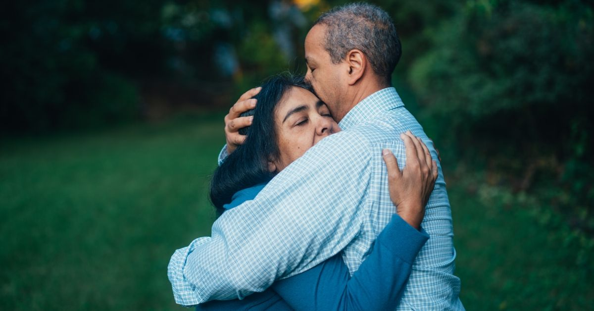 photo of a man hugging a woman