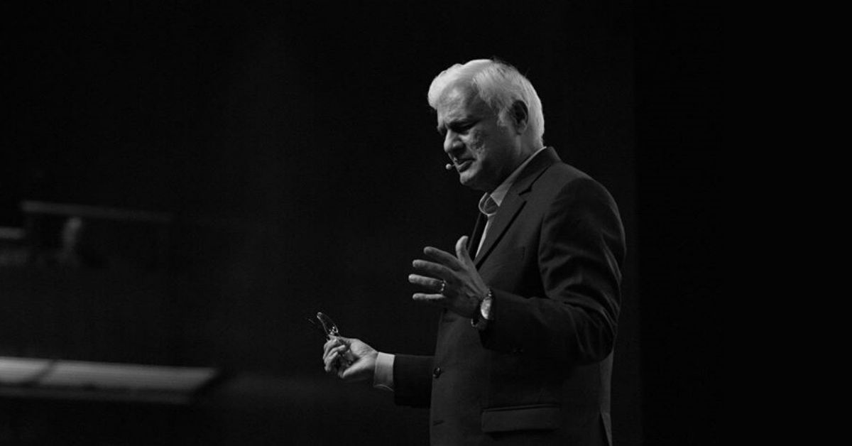 black and white photo of ravi zacharias speaking at a lectern