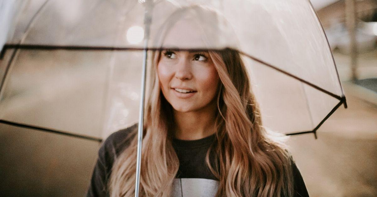 girl standing under an umbrella