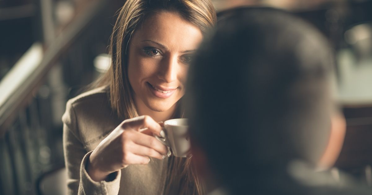 photo of a woman and man having a coffee date