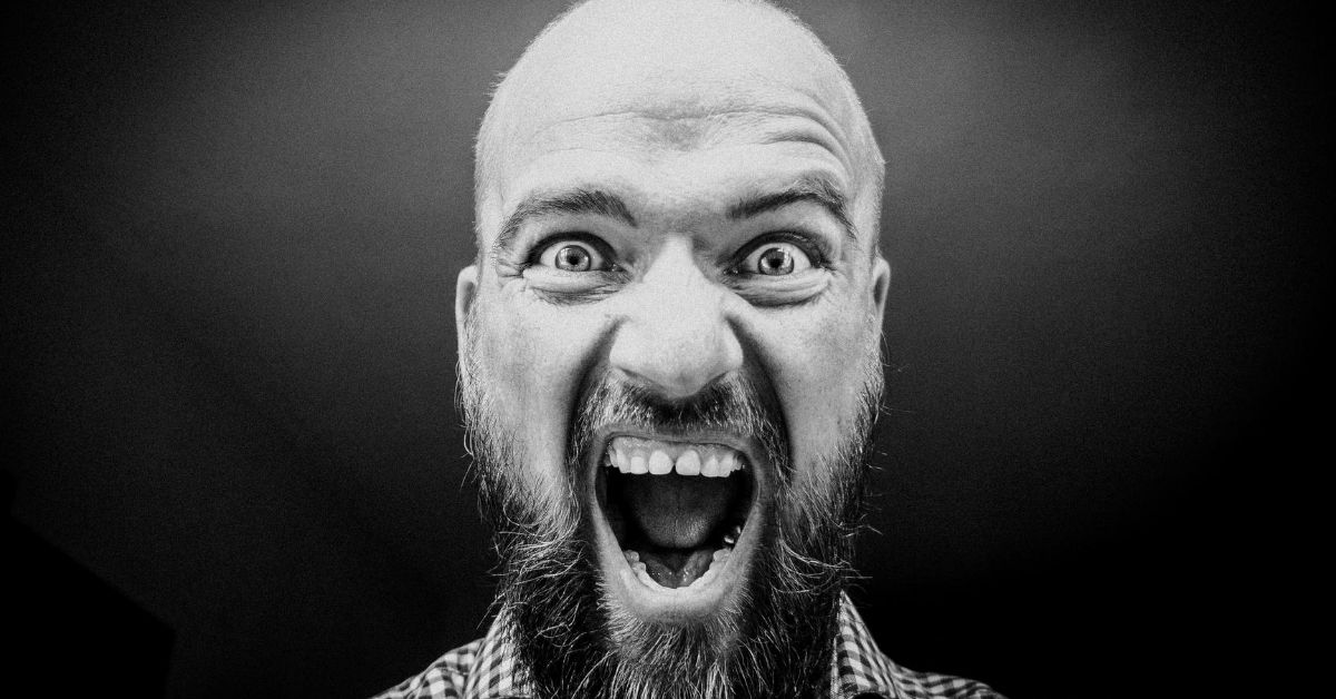 a black and white photo of man yelling