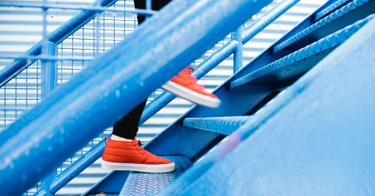 red shoes going up blue stairs